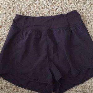 Dark purple high waisted Lululemon shorts